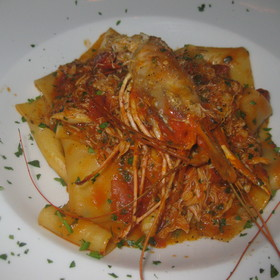 Wide ribbon pasta with fresh Dungeness crabmeat, prawn and spicy tomato sauce