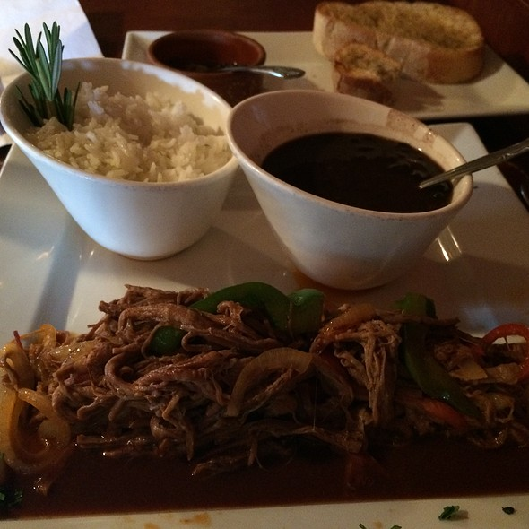 """Ropa Vieja """"Old Clothes""""...Shredded Beef Brisket Slowly Cooked Then Sauteed With Peppers, Onions, Olives & Peas In Tomato & Wine Sauce Served With Riice & Black Beans - Mojito Lounge, Elizabeth, NJ"""