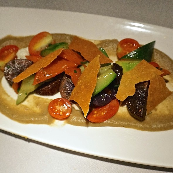 Vegetables with panache – tomatoes, zucchini, red peppers, purple new potatoes, cheese crisps, eggplant purée