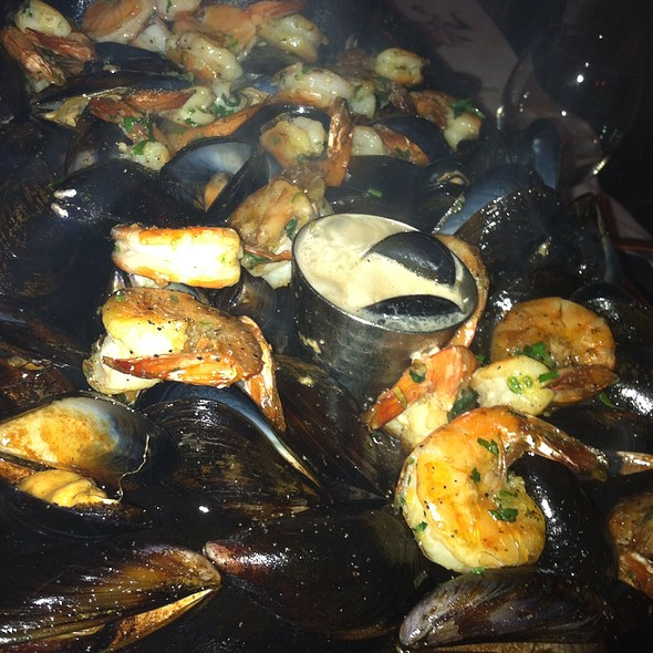 Shrimp And Mussels On A Sizzling Iron Skillet