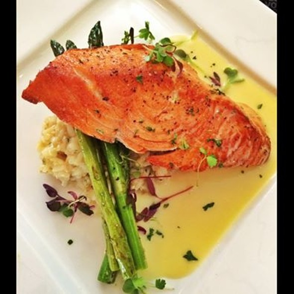 Wild Atlantic salmon on a bed of parmesan risotto, with grilled asparagus in a lemon beurre blanc! - Indulge Bistro and Wine Bar - Golden, Golden, CO