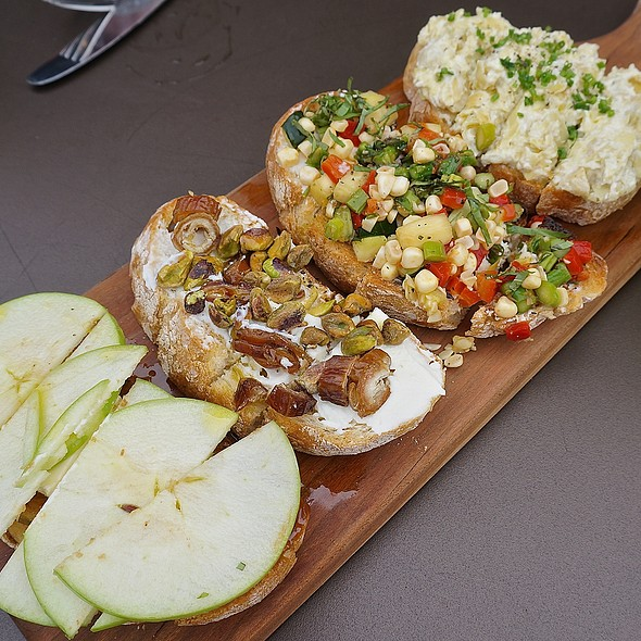 Bruschetta board - artichoke spread; seasonal squash, corn, peppers, asparagus, basil, goat cheese; ricotta, dates, pistachios; brie, apples, fig spread