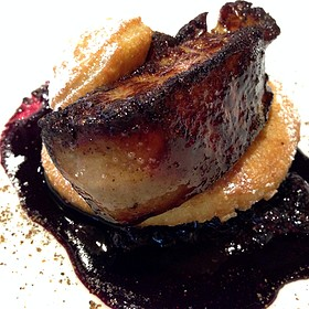 Seared Foie Gras On Doughnut With Huckleberry Reduction Sauce