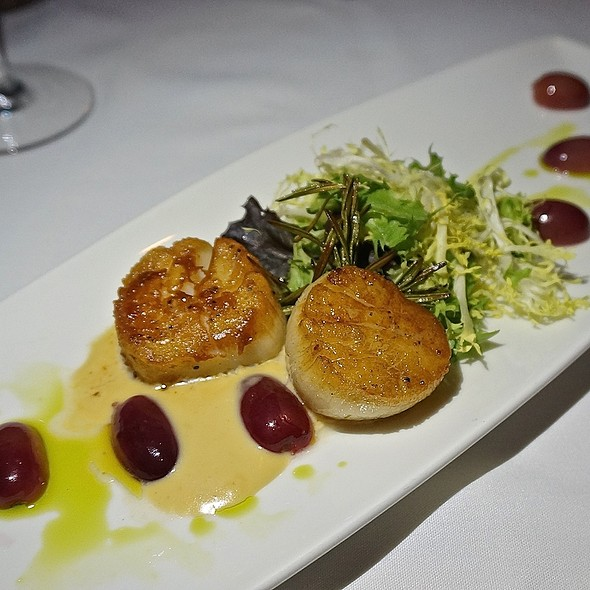 Rosemary pierced diver scallops, pan seared with pickled sweet grapes, citturs butter sauce, micro greens - The Metropolitan, Chicago, IL