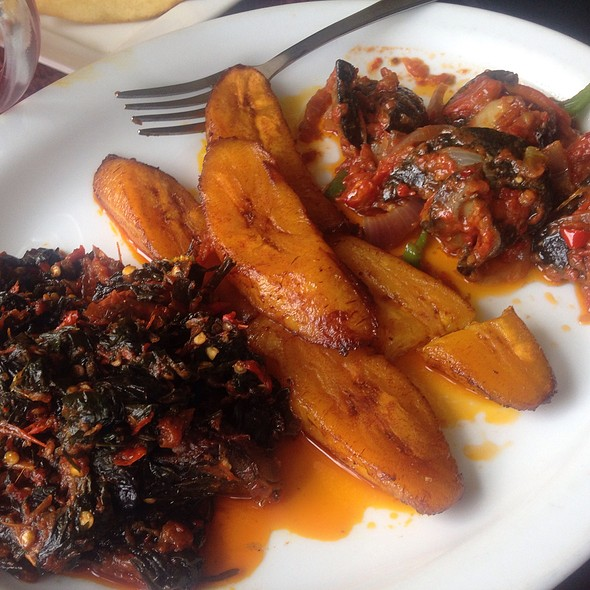 Snails In Tomato Sauce, Fried Plantain And Efo Riro