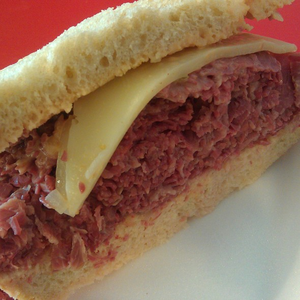 Warm Pastrami Sandwich with Swiss Cheese on Rye Bread @ The Bread Basket Deli