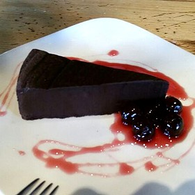 Flourless Chocolate Torte W/ Preserved Cherry Sauce