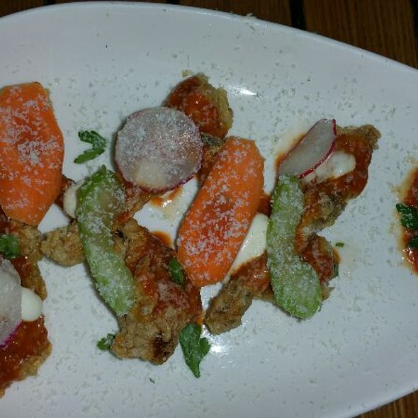 Buffalo Style Frogs Legs, Blue Cheese, Fresh & Pickled Watermelon, Celery Salad