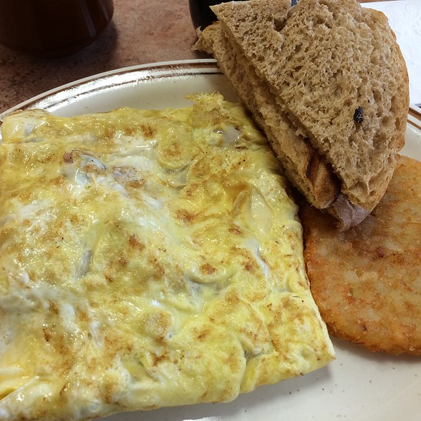 Meat lovers 3 egg omelet, ham, bacon, sausage and cheese with hash brown