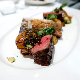Grilled Brandt Family Ranch NY Strip Steak with Crispy Yukon Gold Potatoes,  Horseradish Sour Cream, Roasted Bone Marrow and Red Wine Sauce
