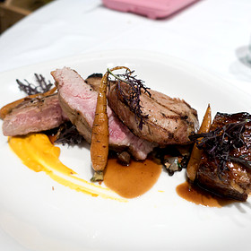 """Grilled Berkshire Pork Chop with Soy Braised Pork Belly,  Garnet Yam Purée, Pickled Chanterelles and Huckleberry Sauce """"Poivrade"""""""