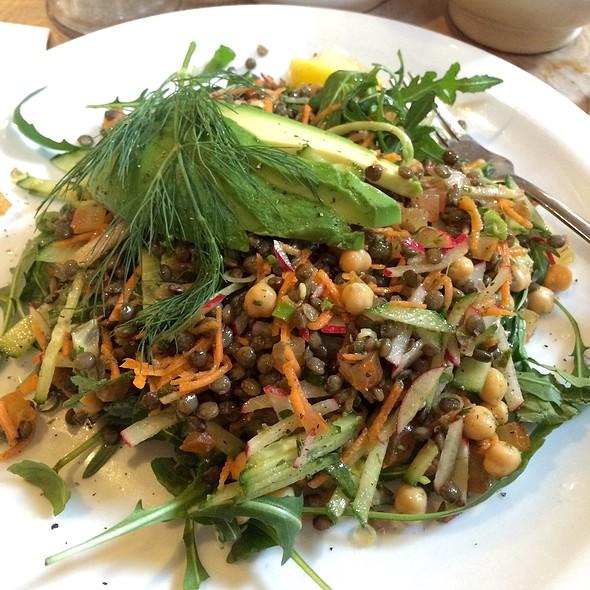 Vegan lentil and avocado salad, arugula, frisée, fennel, carrots, tomatoes, cucumbers, flax seed, basil vinaigrette