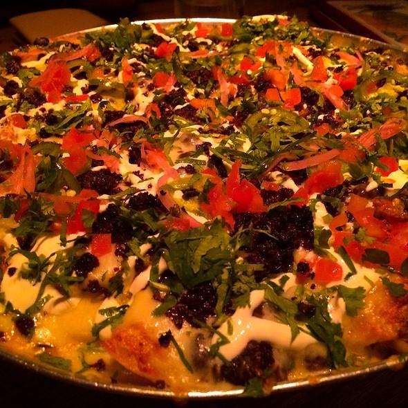 Chorizo Nachos, Queso Sauce, Cilantro, Habeñero Mint Salsa, & Crema @ El Vez