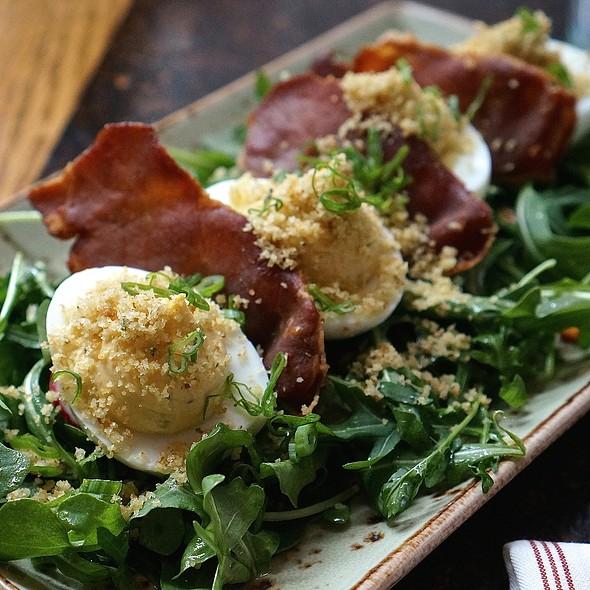 Deviled eggs, sweet potato, sage crouton, La Quercia tamworth ham, arugula - State and Lake Chicago Tavern