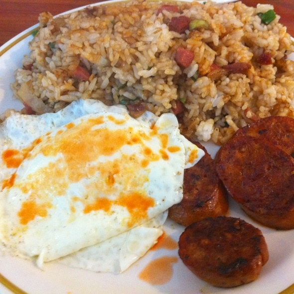Two Eggs Over Easy, Portuguese Sausage & Fried Rice With Tobasco All Over