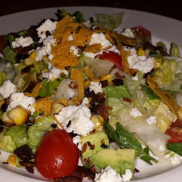 Salad with Mixed Greens, Feta Cheese, Avocado, Grilled Corn, Tomato, Tortilla and Lime Dressing - Sea Watch Restaurant, Fort Lauderdale, FL