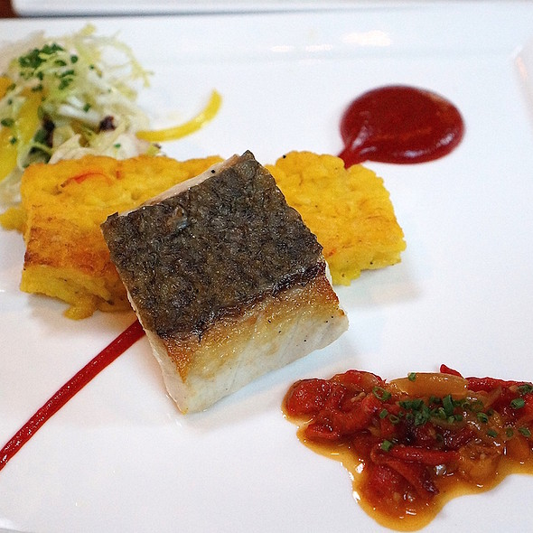 Crispy skin sea bass, saffron risotto pavé, charred octopus, roasted pepper sofrit @ Valette