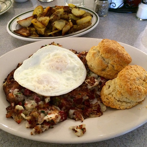 Corned Beef Hash With Fried Egg, Home Fries, And Biscuit