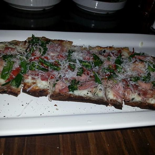 Brick Oven Pizza With Prosciutto,  Arugula, And Parmesan - Stella Modern Italian Cuisine, Oklahoma City, OK