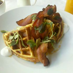 Waffles With Whipped Creme Fraiche And Vanilla Maple Syrup With Bacon