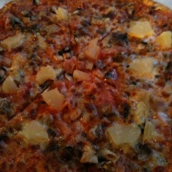 Proscuitto And Mushroom Pizza With Pineapples @ Restaurant La Cina