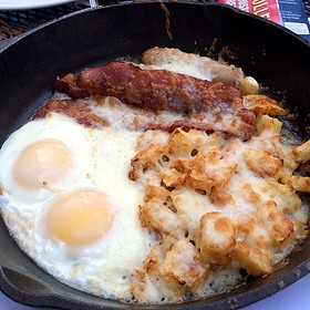 Skillet Breakfast, Applewood Smoked Bacon, Maple Sausage, Home Fries, Eggs and Cheddar Cheese Baked in a Cast Iron Skillet