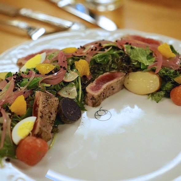 Tuna nicoise salad, tomato confit, potatoes, snap peas, mustard vinaigrette