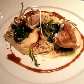 Cornish Game Hen Baked In Clay With Potatoes And Spinach