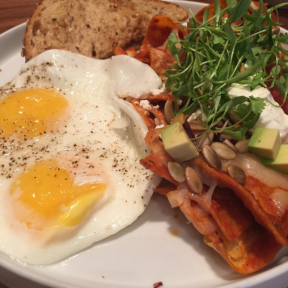 Chilaquiles, fried egg black beans, cheese, chili peppers at Tackle ...