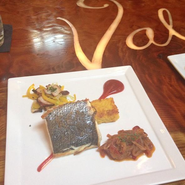 Crispy skin sea bass, saffron risotto pavé, charred octopus, roasted pepper sofrit @ Valette