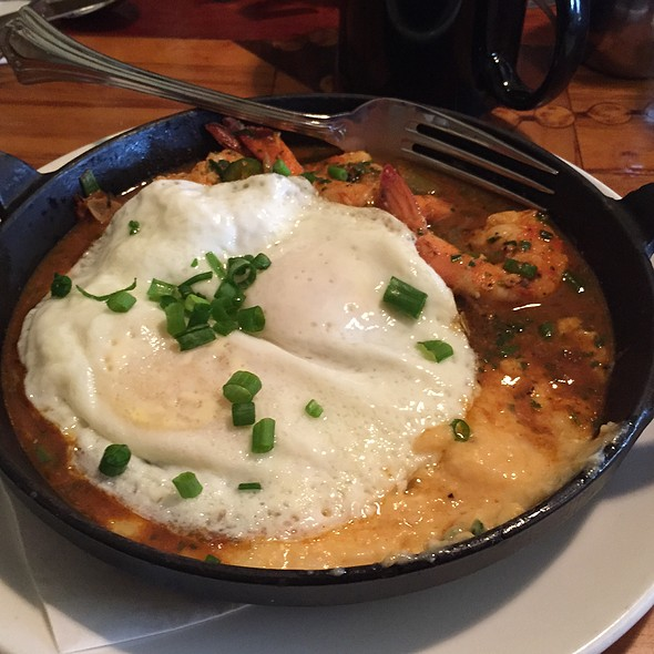 Spicy Creole Shrimp And Eggs Over Cheesy Grits