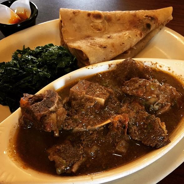 Mbuzi Mchuzi (Goat Stew), Chapati (Kenyan Flatbread), Sukuma Wiki (Collard Greens)