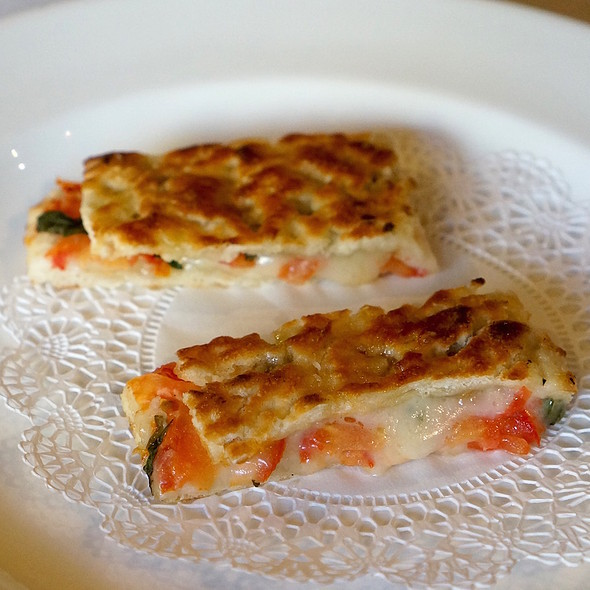 Amuse bouche – mini tomato, fontina, arugula panini