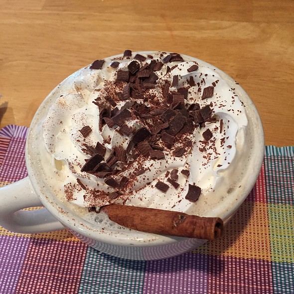 Kaffe Mit Schlag, Hot Coffee Toped With Whipped Cream. Garnished With Shaved Chocolate And A Cinnamon Stick @ Yummies Bistro