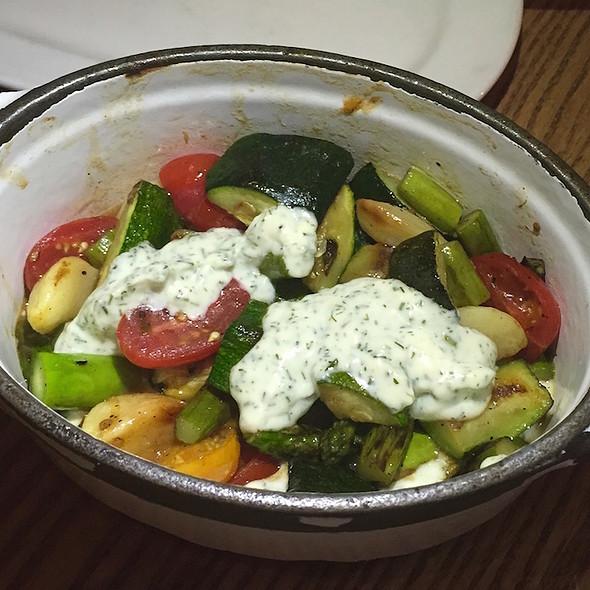 Green asparagus, baby zucchini, spring onion, grape tomato, dill yogurt, roasted garlic cloves @ Nellcôte