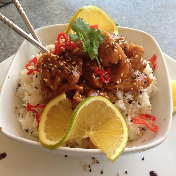 Spicy Sesame Orange Chicken On Coconut White Rice
