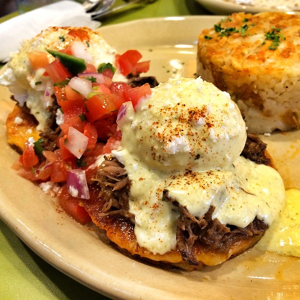 Chilaquiles Eggs Benedict With Barbacoa Beef at Snooze