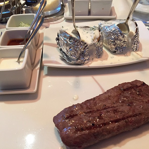 Lamb With Baked Potatoes And Sour Cream @ Restaurant Kuonimatt