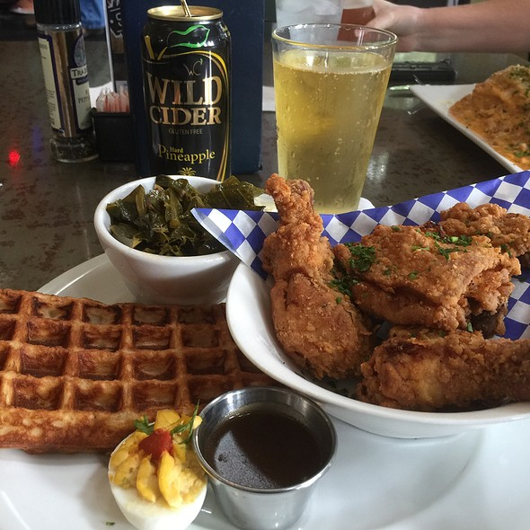 Ellas Fried Chicken And Waffles Tarragon & Buttermilk Marinated, Corn Flake Fried 2Dtrundticks & 1 Thigh With Belgian Waffle , Bourbon Maple Gravy & Collard Greens With Bacon Wild Cider Hard Pineapple