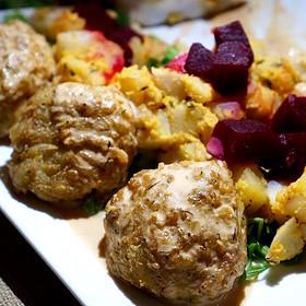 Jumbo lump crab cake, brunoise root vegetables, sweet corn shellfish velouté