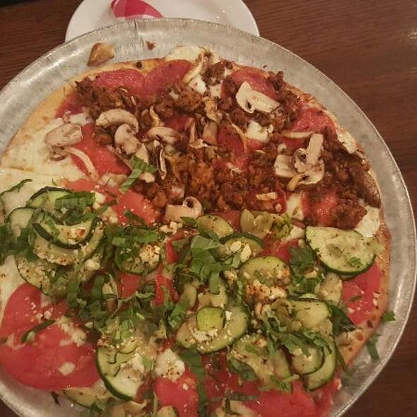Half Veggie Half Meat Pizza