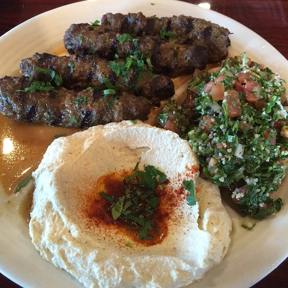Kafta Combination, charbroiled kabobs of ground beef, parsley, onions and spices, served with hummus, tabouli salad and tahini sauce @ Norma's Mediterranean Restaurant