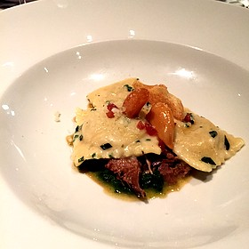 Chestnut And Butternut Squash Ravioli Over Ragout Of Braised California Lamb, Lacinato Kale And Pancetta With Candied Garlic