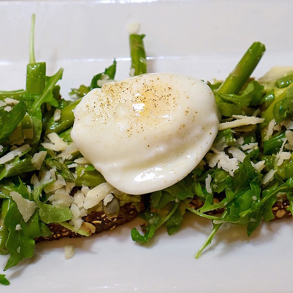 Avocado and asparatus tartine –  arugula, poached egg, pumpkin seeds, parmesan, olive oil - Tartinery, New York, NY