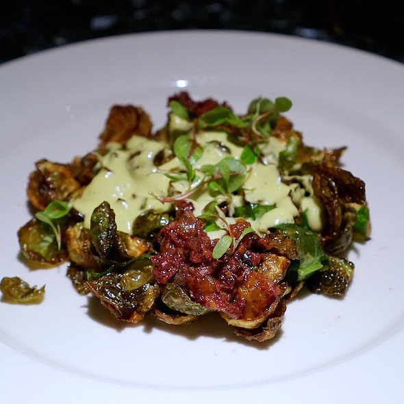 Fried Brussels sprouts, hen of the woods mushrooms, cipollini onion aigre doux, thyme hollandaise, olive tapenade, sorrel - Vie, Western Springs, IL