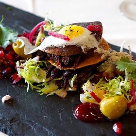 Braised pheasant, socca crêpe Napoleon, spiced yogurt, pomegranate fruit and gel, olives, radicchio