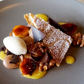 Chocolate mousse, butter puff pastry, banan-rum sorbet, caramelized bananas, passion dots, walnuts