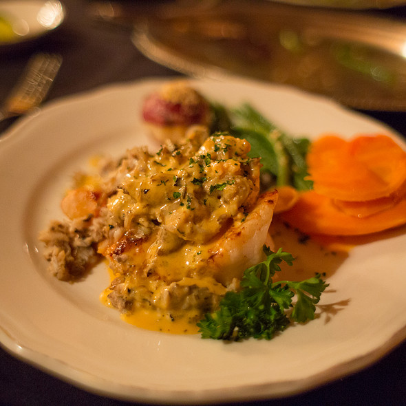 Baked Grouper Topped With Crab and Champagne Sauce - The Library Restaurant - Myrtle Beach, Myrtle Beach, SC