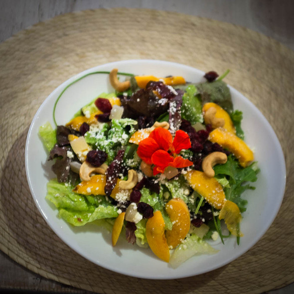 Salad with peaches and cashews  @ La Olla