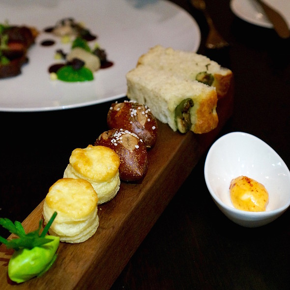 Buttermilk biscuit, caraway pretzel roll, olive focaccia with herb butter, lamb butter, piperade butter and Greek yogurt butter